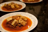 Braised oxtail stew with pan-fried gnocchi