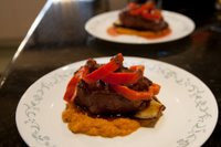 Summer fillet on a bed of pumpkin mash and grilled aubergine with layered fresh sweet capsicum