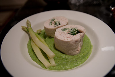 Spinach, ricotta, and English streaky bacon-filled chicken roulade, on a bed of green asparagus and potato puree, with some white asparagus on the side