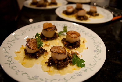 Ma hor (galloping horses,) a Thai dish involving slices of fresh pineapple, minced duck with garlic, chilli and coriander, with seared scallops on top