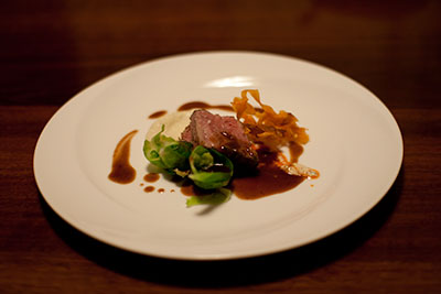 72-hour slow-cooked beef short rib, with parsnip and vanilla puree, brussels sprouts, sweet potato crisps and a beef jus