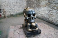 Skull biting man statue in Prague, Czech Republic