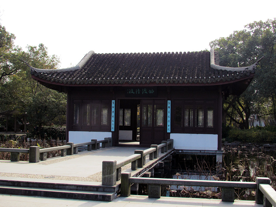 Chinese building on a bridge by West Lake