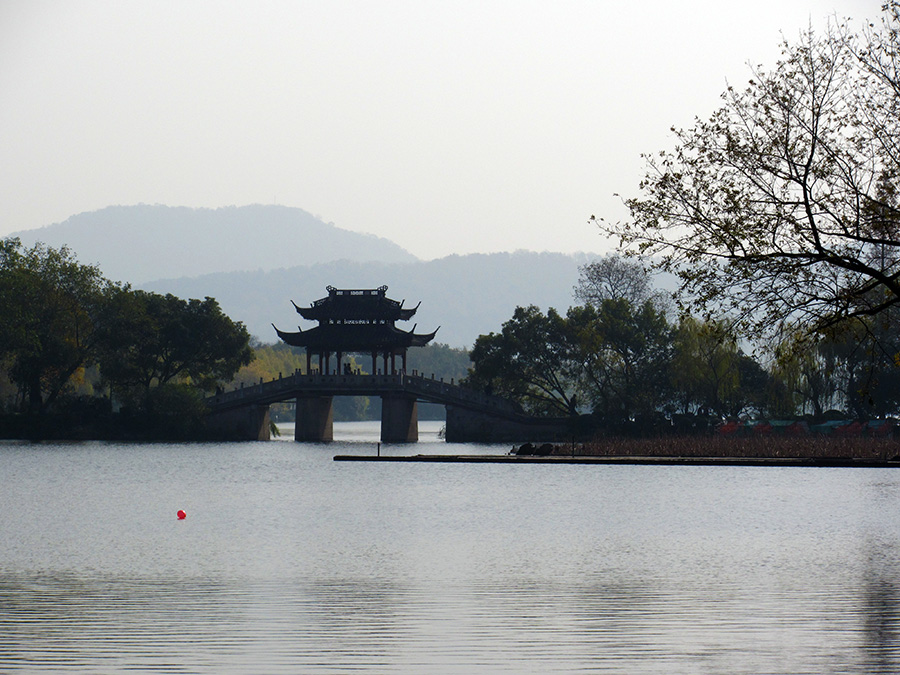 Another Chinese building in the middle of a bridge over West Lake