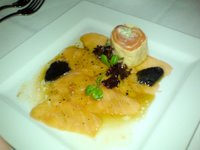 Perigord truffle and salmon carpaccio in truffle ponzu dressing, with smoked salmon filled egg crepe roulade