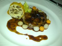 Prime beef fillet and braised oxtail on a shallot and vegetable cassoulet