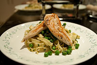 Hand-made basil and pea fettucine with seared chicken breast