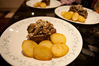Beef fillet with a mixed mushroom gratin and sauteed potatoes
