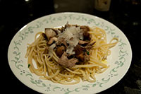 Twice-cooked duck confit with a mixed mushroom, truffle oil linguine