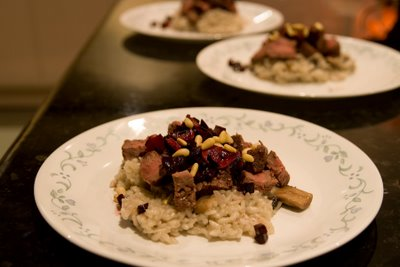 Beef fillet risotto with beetroot, bloodied garlic chips, and toasted pine nuts