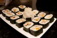 Chicken katsu sushi maki with an onigiri spy lurking amidst